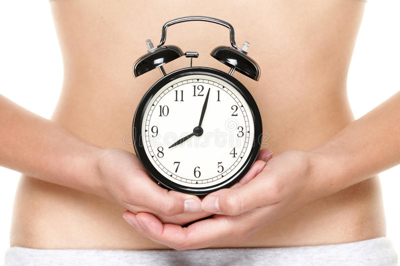 Biological clock ticking - woman holding watch royalty free stock photos