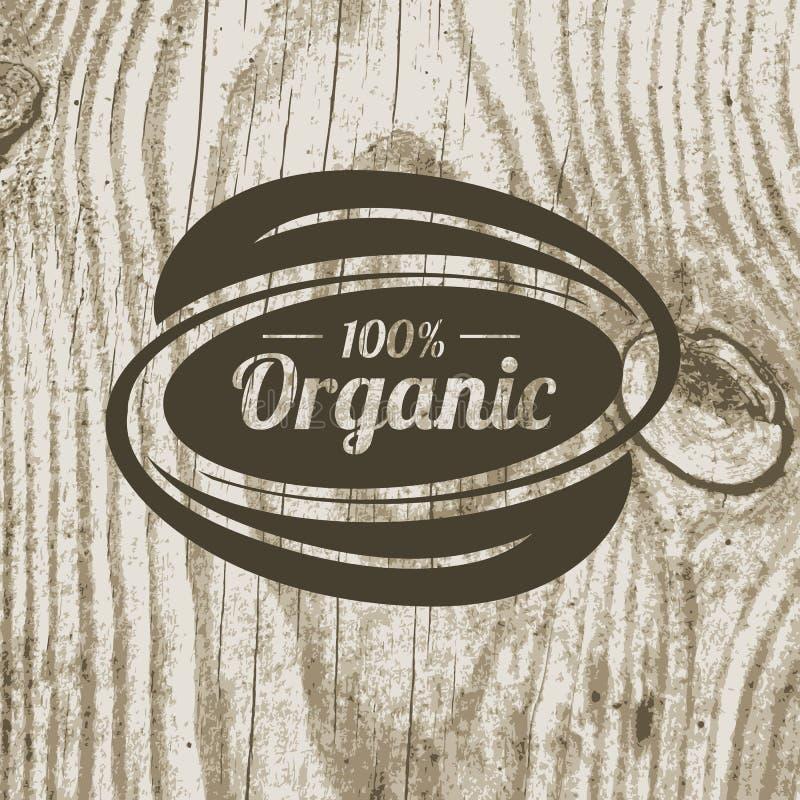 Biologisch productkenteken met bladeren op houten textuur Vectorillu royalty-vrije illustratie