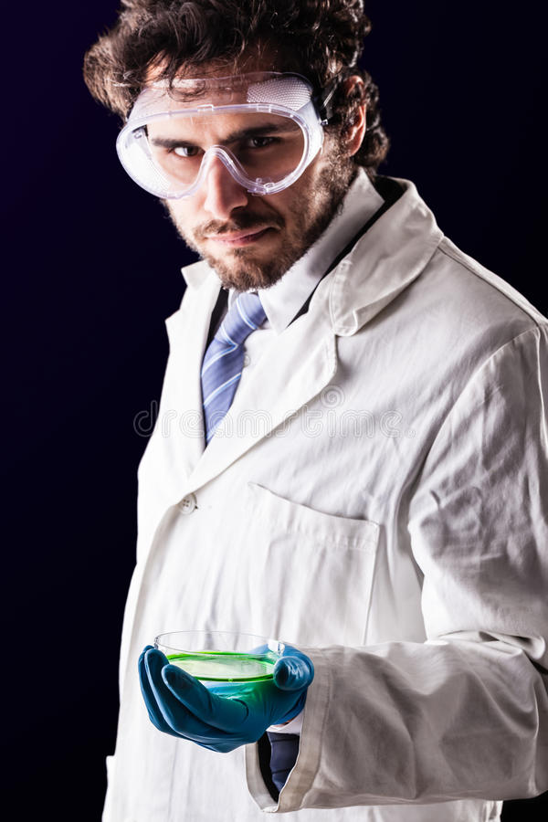 Biologist holding a petri dish stock image