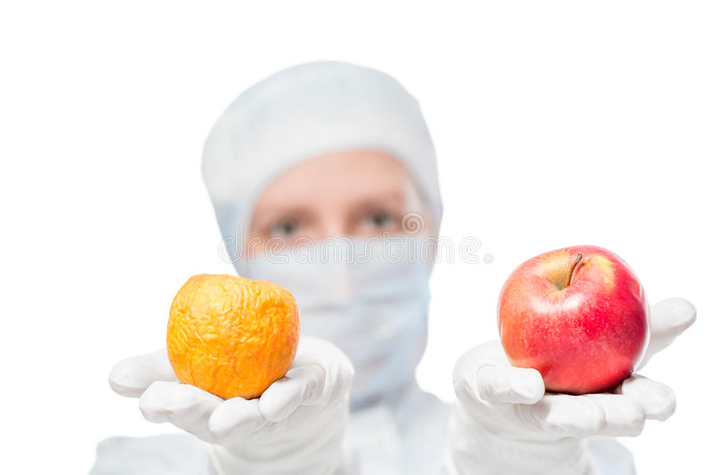 Biologist shows the result of the impact of toxic substances. On the apple royalty free stock photo