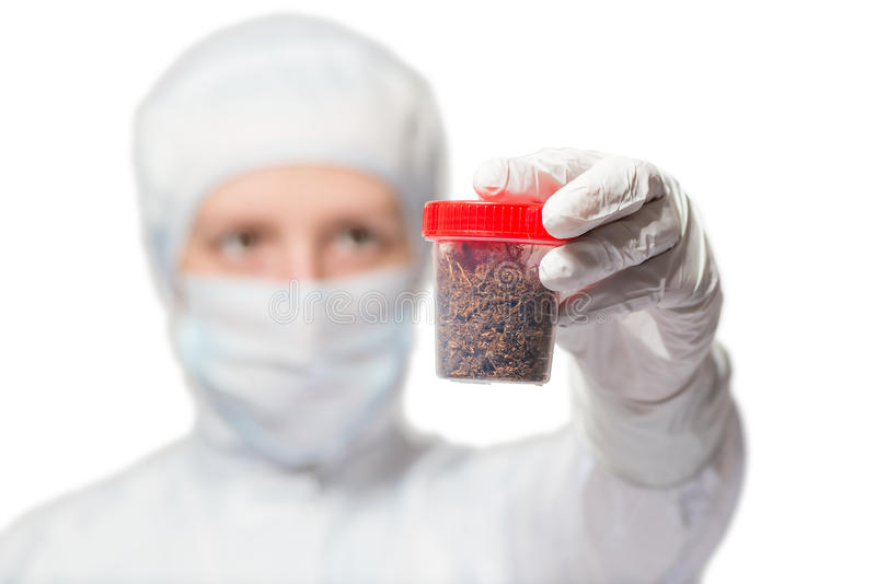 Biologist shows a sample of the soil in a test tube on a white. Background royalty free stock photos