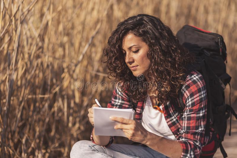 Biologist taking notes while on field trip royalty free stock photos