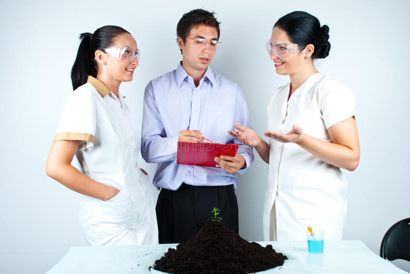 Biologist team having discussion in laboratory royalty free stock images