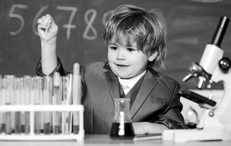 Biology school lab equipment. kid scientist studying science. Little boy at the elementary school. Little kid learning. Chemistry in school laboratory. little royalty free stock image