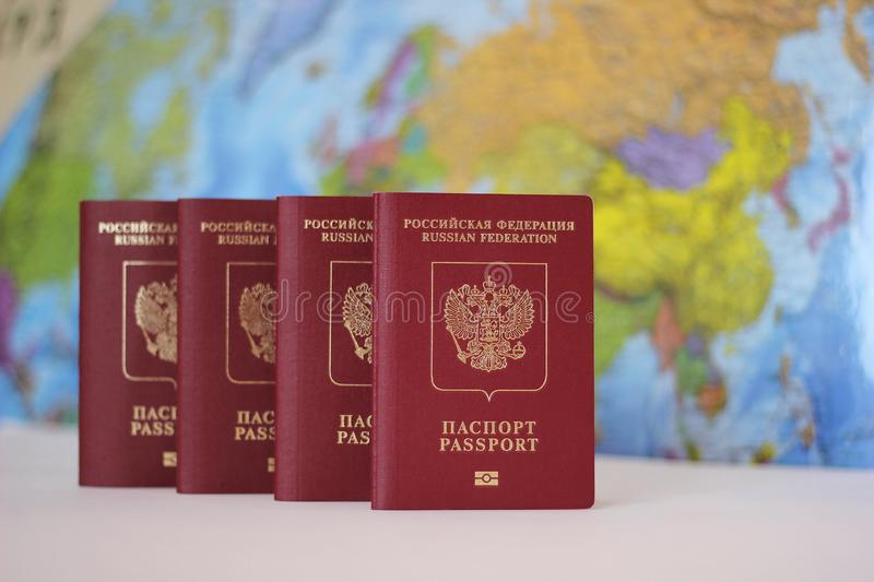 Biometric russian passports are in a row on the background of the world map. . The passport of the Russian Federation royalty free stock photo
