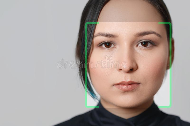 Biometric verification woman face recognition detection security stock photo