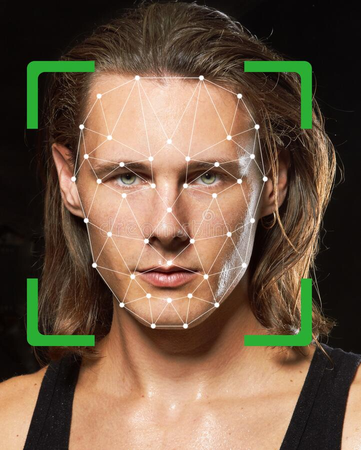 Biometric verification. Young man. The concept of a technology of face recognition on polygonal grid royalty free stock photos