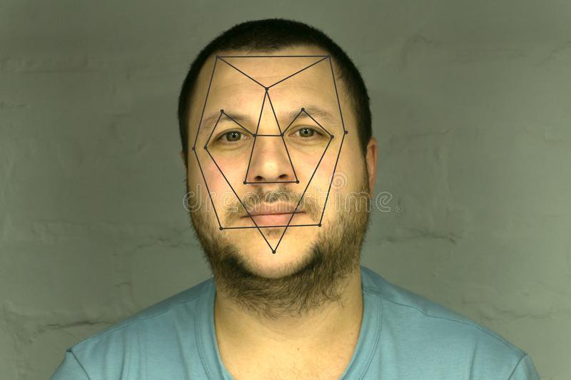 Biometric verification - young man face recognition royalty free stock image