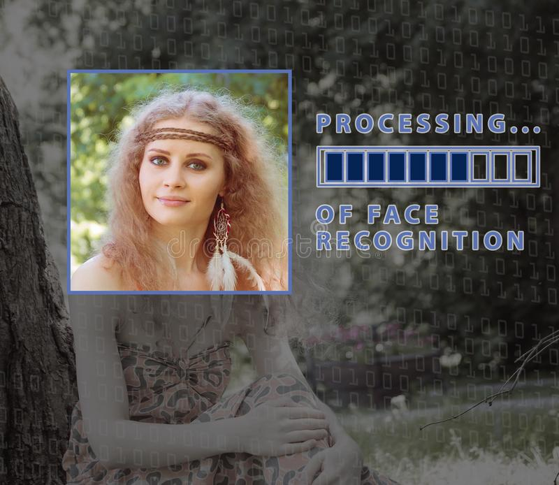 Biometric verification. young woman with status bar. The concept of a new technology of face recognition. Biometric verification. young woman with status bar royalty free stock image