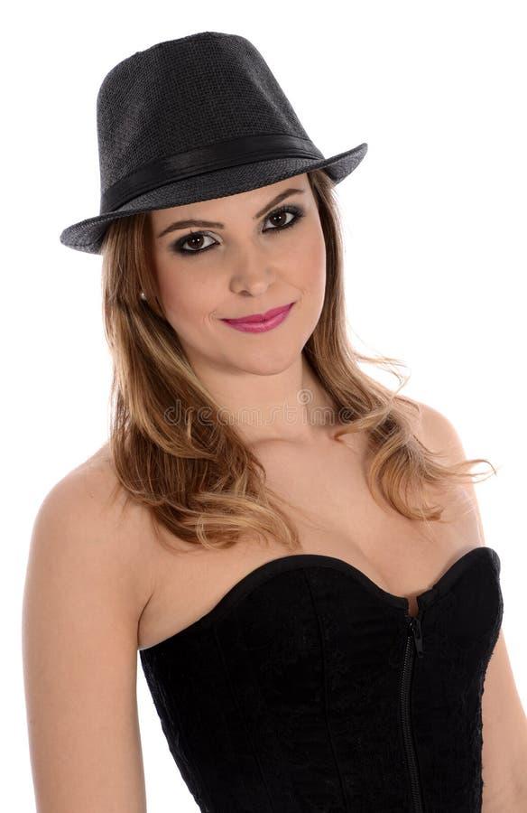 Bionda graziosa con un black hat fotografie stock