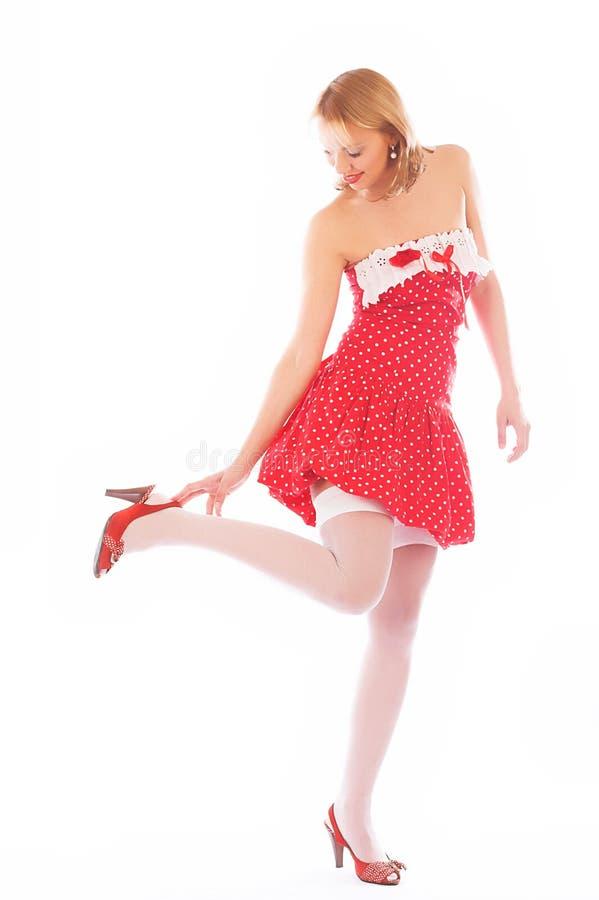 Biondo in vestito rosso fotografia stock