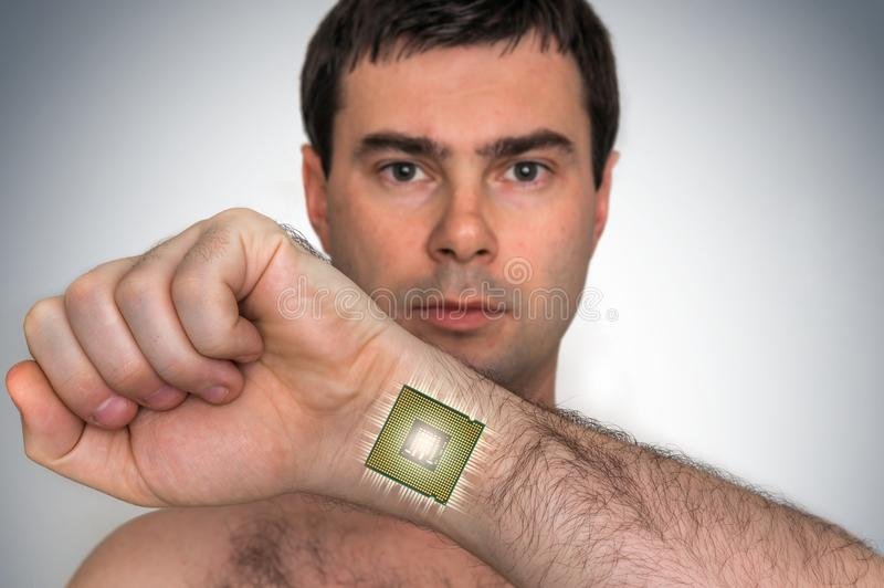 Bionic microchip processor inside male human body. Future technology and cybernetics concept royalty free stock photo
