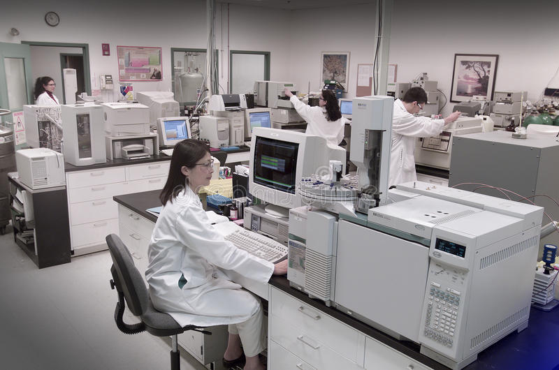 Biotech laboratory. Young scientists working in modern biological lab stock photos