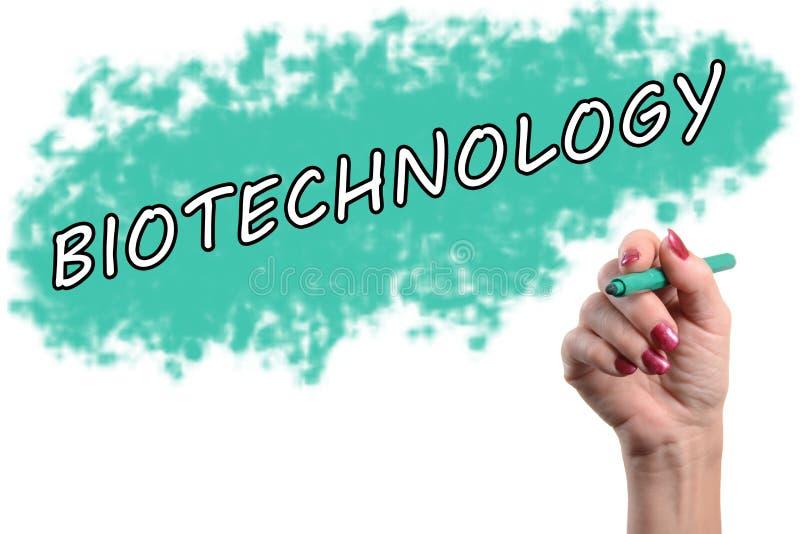 Biotecnología de la palabra escrita por una mano fotografía de archivo libre de regalías