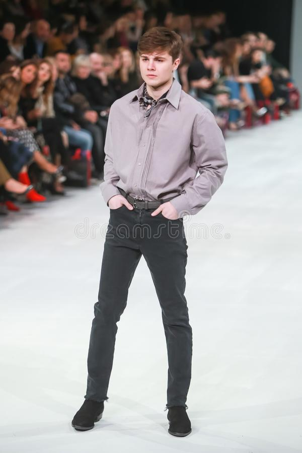 Bipa Fashion.hr fashion show 2018 : Robert Sever. ZAGREB, CROATIA - MARCH 23, 2018 : Fashion model wearing clothes for spring - summer, designed by Robert Sever royalty free stock image