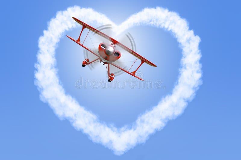 Biplan tworzy kierowego kształt w niebie zdjęcie royalty free