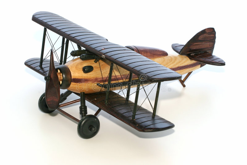BiPlane. A wood model biplane over white stock photography