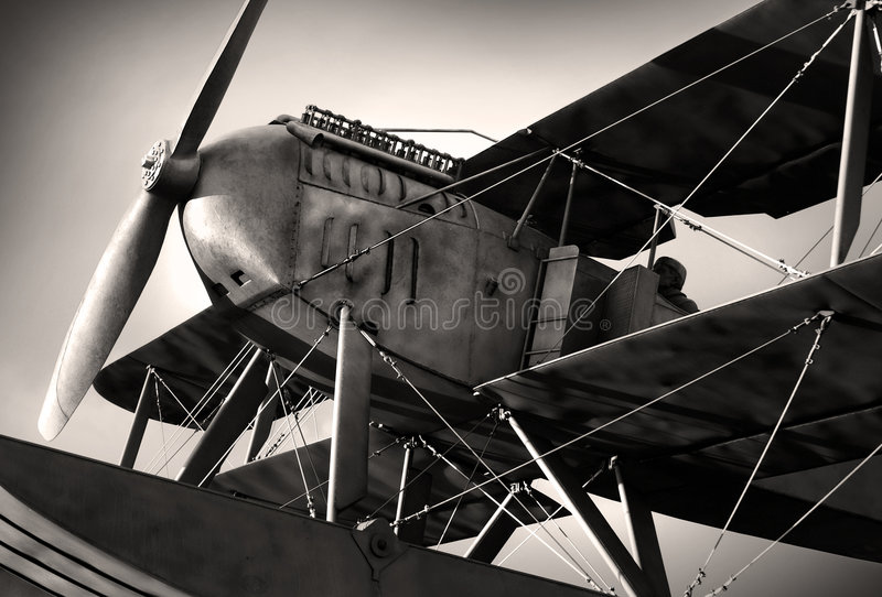 Biplane. Detail of a old biplane from the nineteen-twenties in sepia tone royalty free stock photo