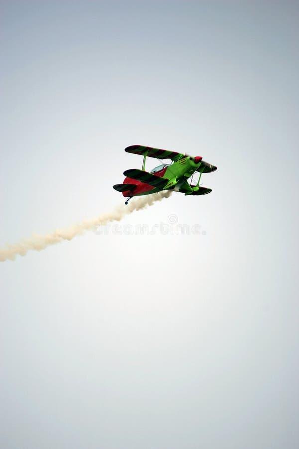Biplane. With trailing smoke stock photos