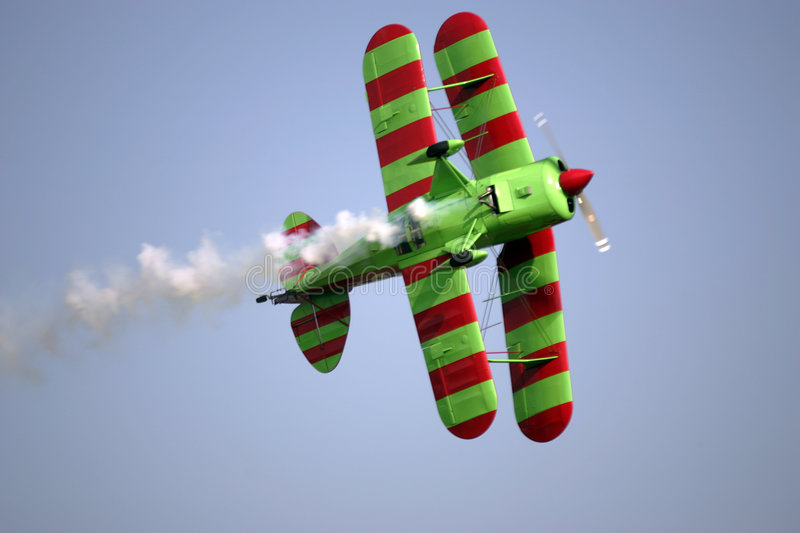 Biplane. With trailing smoke royalty free stock photography