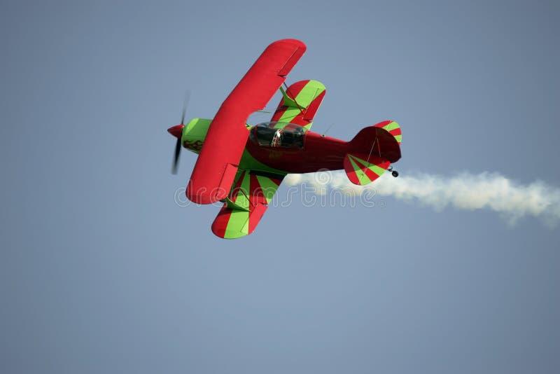 Biplane. With trailing smoke stock photography