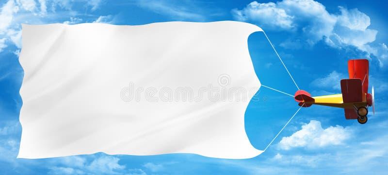 Biplane advertising. On a blue sky royalty free illustration