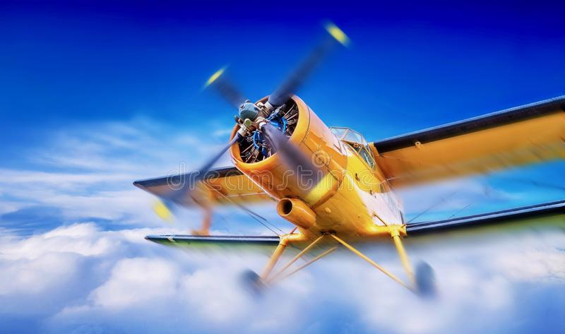 Biplane. Breaks through the clouds royalty free stock photos