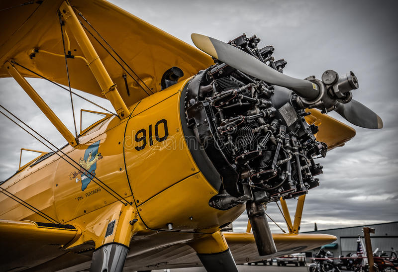 Biplane Engine. Redding, California, USA- September 28, 2014: A high performance stunt biplane and its engine are on display at an airshow in Northern California royalty free stock images