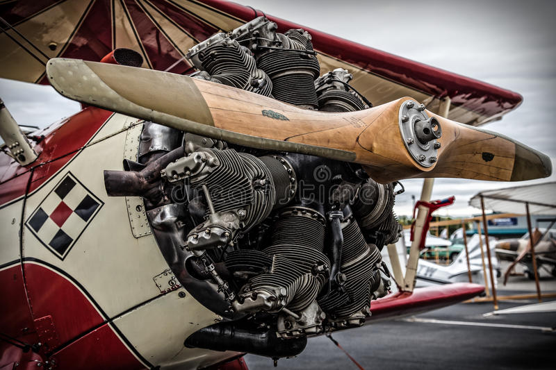 Biplane Engine. Redding, California, USA- September 28, 2014: A high performance stunt biplane and its engine are on display at an airshow in Northern California royalty free stock image