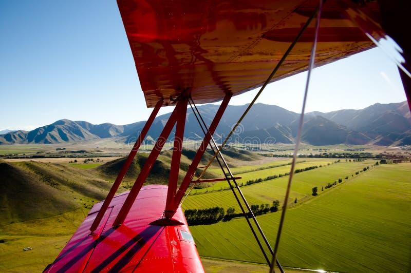 Biplane in Flight. New Zealand stock photo