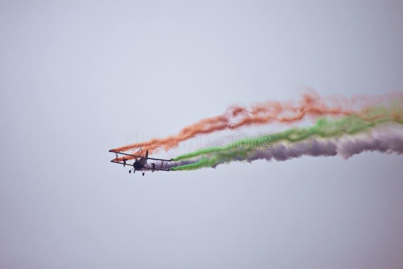 Biplane flying at Aero India royalty free stock photography