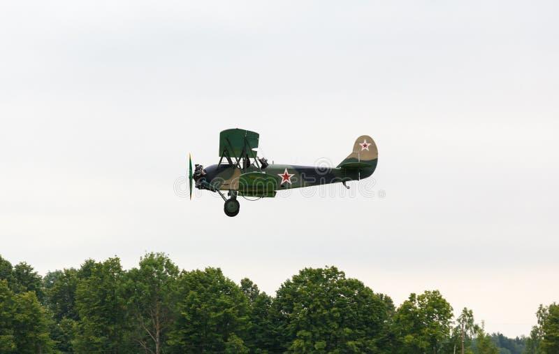 Biplane Polikarpov Po-2, aircraft WW2. Biplane Polikarpov Po-2 on the background of the cloudy sky, the aircraft WW2 royalty free stock images