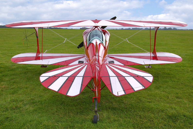 Biplane rear view. Rear view of a red biplane, now used for aerobatics royalty free stock image