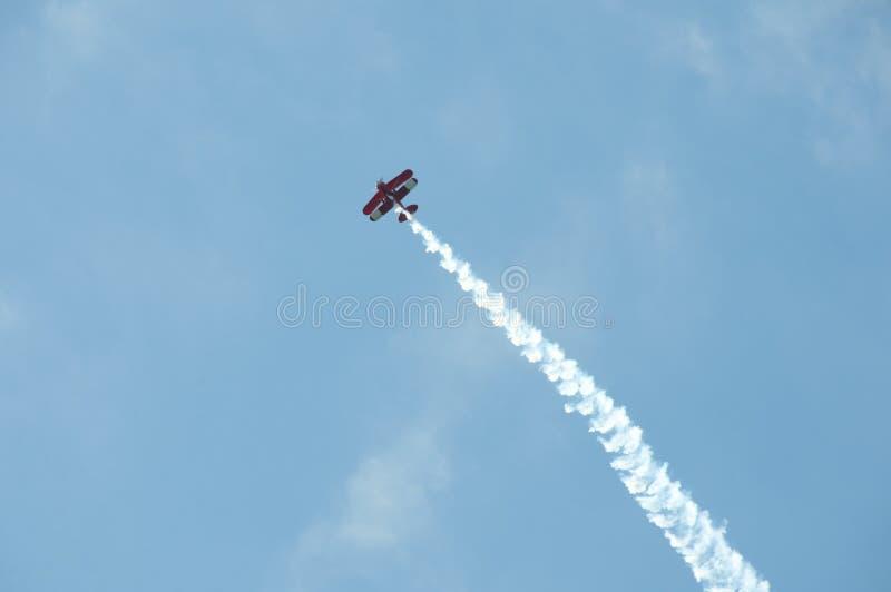 Biplane Smoke Trail. Sydney - Australia stock photo