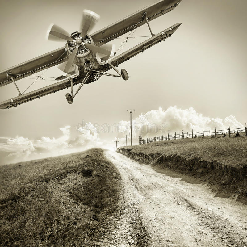 Biplane. Vintage biplane against the sky royalty free stock photography