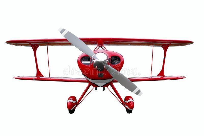 Biplano vermelho cortado fotografia de stock