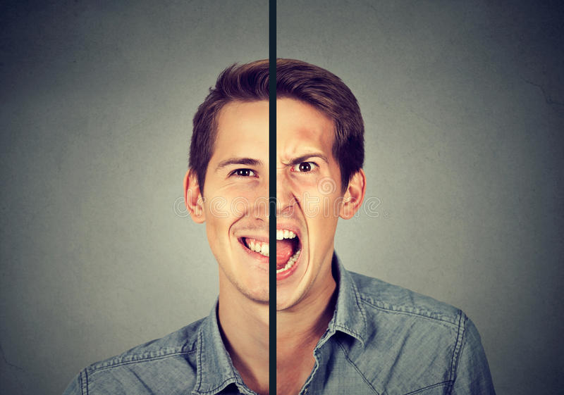 Bipolar disorder concept. Young man with double face expression stock photography