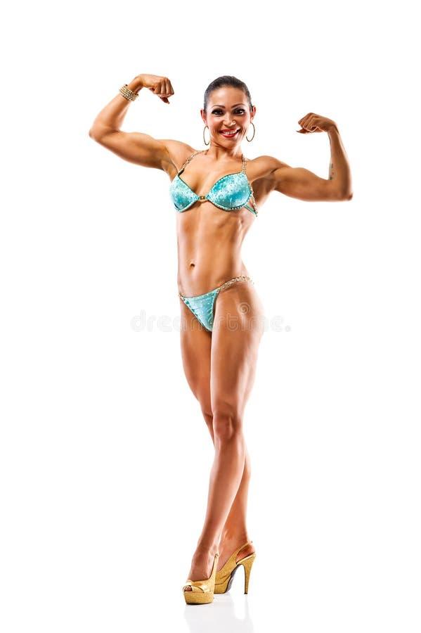 Biquini vestindo da menina atlética bonita que levanta sobre o branco imagem de stock