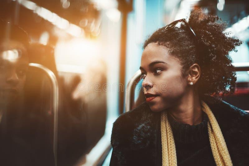 Biracial девушка в метро стоковые фото