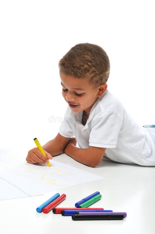 Biracial boy coloring royalty free stock image