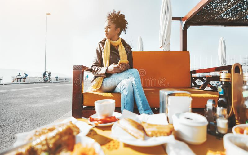 Biracial female in an outdoor cafe stock photo
