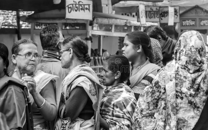 Birbhum district, West Bengal, India May 2018 - Group of Active senior citizen Bengali women standing in a row outside pooling royalty free stock images