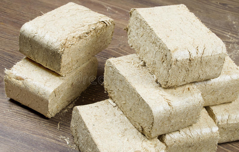 Birch Briquette. Wood briquette ready to be used stock images