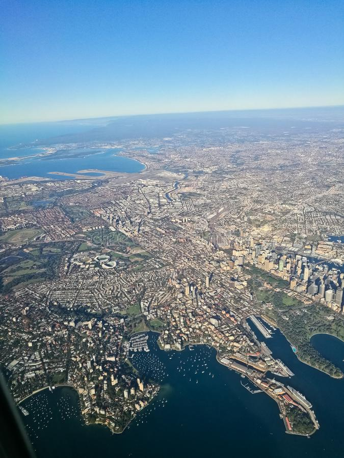 Bird eye view aerial scene of Sydney Australia city center from. An airplane window royalty free stock photo