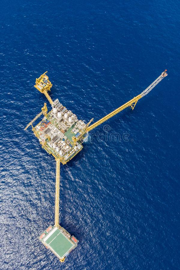 Bird eye view of offshore oil and gas central processing platform which comprised of central facility, accommodation area, flare. And remote platform, power and stock photography