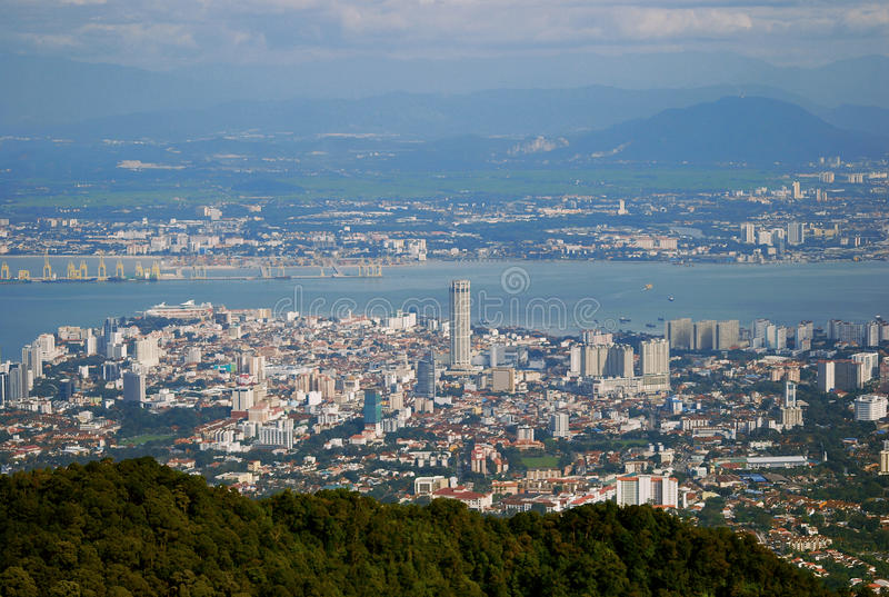Bird Eye view from Penang Hill. The iconic building in Penang,KOMTAR Tower with mainland, sea and Penang Port. Background royalty free stock photo