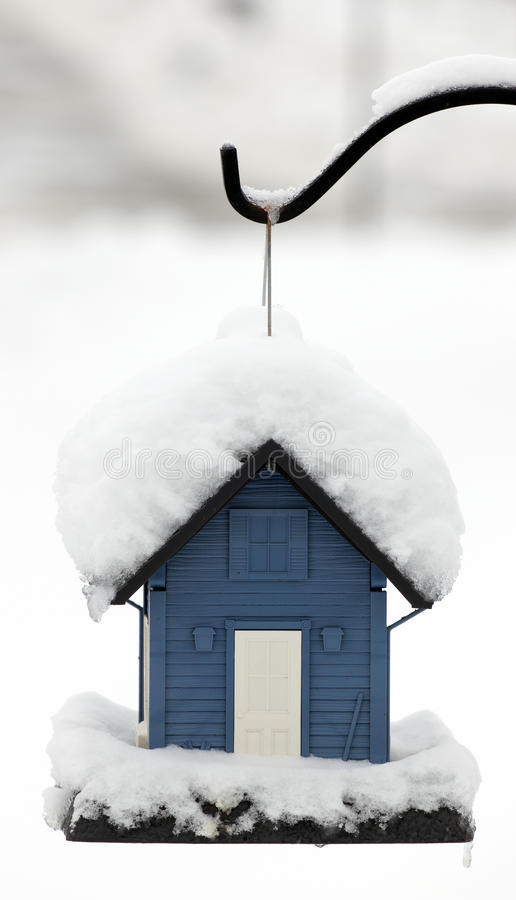 Bird feeder covered in snow stock photos