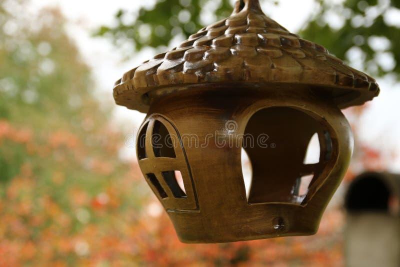 Bird feeder house. With bird food royalty free stock photo