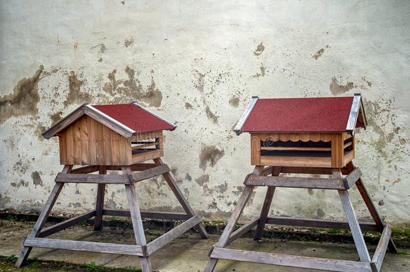 Bird feeders. Houses in a farm backyard stock images