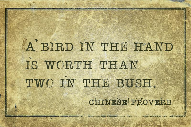 Bird hand CP. A bird in the hand is worth than two in the bush - ancient Chinese proverb printed on grunge vintage cardboard vector illustration
